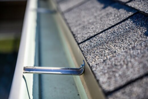 clean empty gutter on side of roof - A1 Pro Roofing Ottawa Kanata Orleans