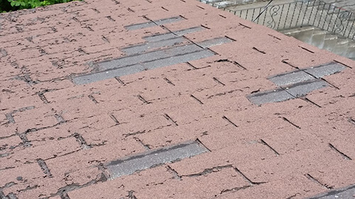 badly damaged shingles in need of roof repair - A1 Pro Roofing Ottawa Kanata Orleans