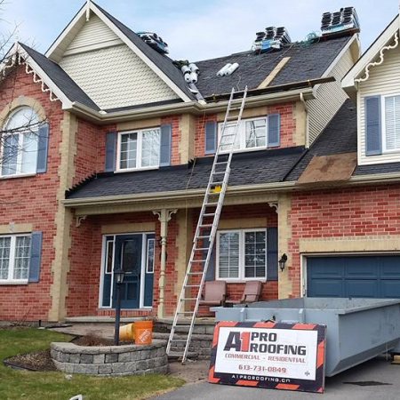 roofing project in progess, ladder leads up to roof, shingles sit atop roof - A1 Pro Roofing Ottawa Kanata Orleans